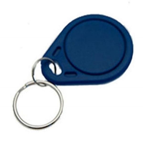 Nøglevedhæng/Key Change med TK4100 kompatibel chip,  blå overflader. Format: 40 x 30 x 3 mm. Denne chip understøtter kortlæsere til EM 4100, EM 4102 og EM 4200. Fra RD Data