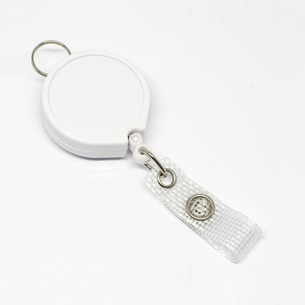 Praktisk 35 mm yoyo med nylonsnor, bælteclip på bagsiden, metaltryklås på båndet og ring til f.eks. en lanyard.